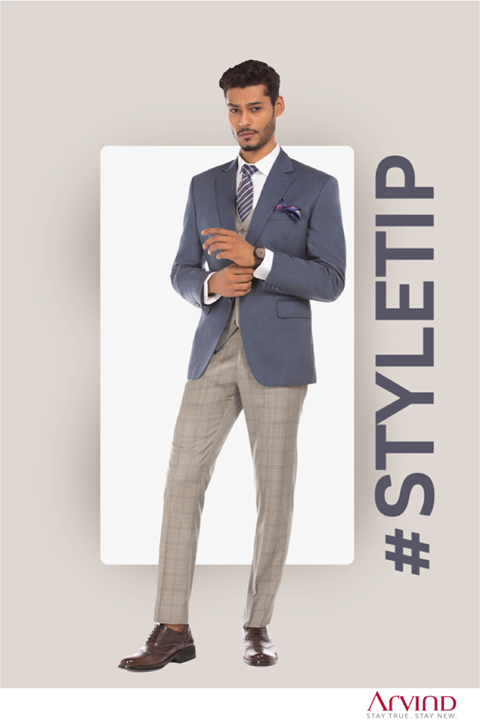 A classic blue blazer teamed up with check trouser and waist coat sums up the perfect look for mid-week meeting.