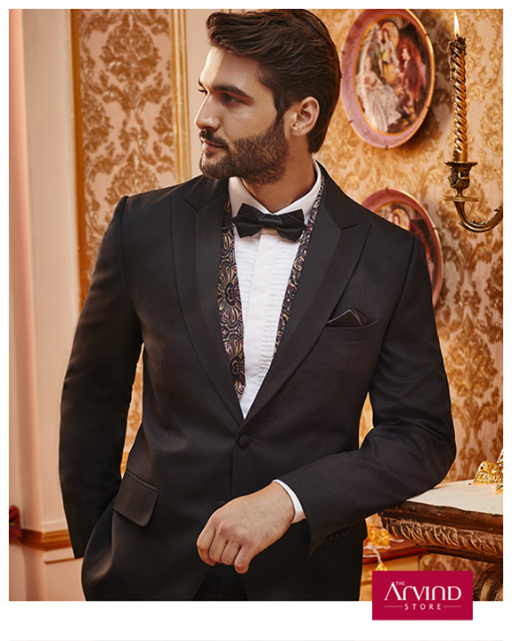 Radiate stylish energy by donning this black cut and sew lapel suit. Leave a mark by pairing it with a white shirt. To know more, book an appointment - http://bit.ly/TASBookAnAppointment