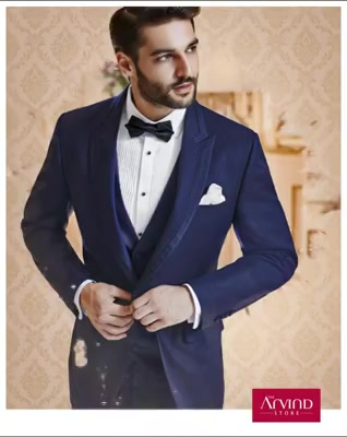 Give your cocktail party a creative touch. Flaunt your unique style by pairing this navy 3 piece cut & sew peak lapel suit with pleated tuxedo shirt and a bow tie. Book an appointment today -  http://bit.ly/TASBookAnAppointment