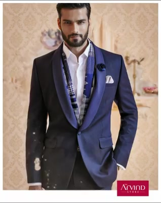 This navy blue textured shawl collar suit, paired with a white front pleated shirt ticks all the boxes when you aim to be the best-dressed guest at your colleague's reception. To know more, book an appointment - http://bit.ly/TASBookAnAppointment