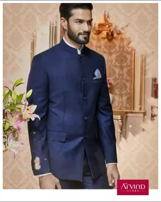 Make your Sangeet ceremony extraordinary by pairing this navy blue bandhgala with a white cotton shirt. To know more, book an appointment - http://bit.ly/TASBookAnAppointment